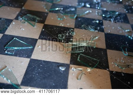 Pieces Of Shattered Glass Or Mirror In An Abandoned House On The Floor