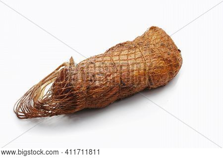 Smoked Loin, Sirloin In Herbs In One Piece, In Netting, Isolated On A White Background. A Homemade,