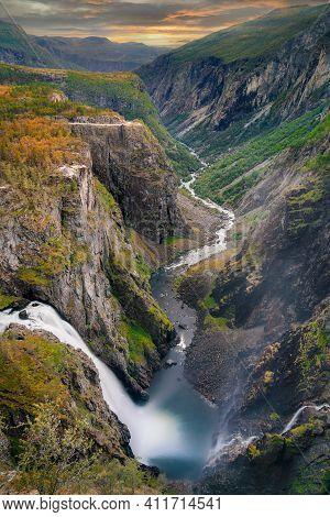 Classic Voringfossen Double Waterfall Shot From Above. Shot Is A Long Exposure During Sunset In Autu