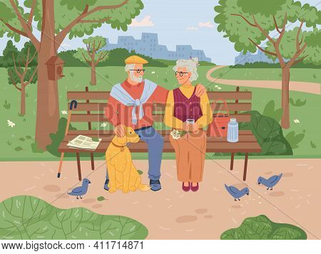 Elderly People Sitting On Bench In Park, Feeding Pigeon Birds, Green Trees And Grass On Background.
