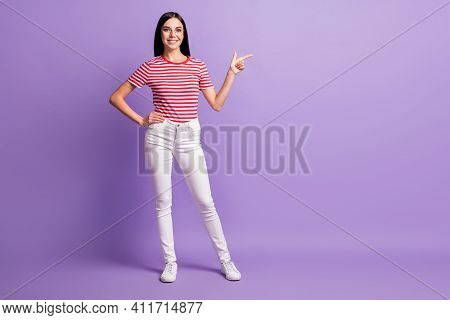 Full Size Photo Of Beautiful Happy Young Woman Point Empty Space Advert Wear White Pants Isolated On
