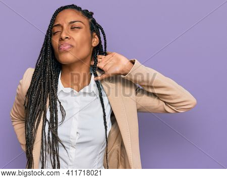 African american woman wearing business jacket suffering of neck ache injury, touching neck with hand, muscular pain