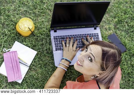 Woman 40 Years Old Working Outdoors With Laptop While Making Healthy Breakfast - Smiling Female Entr