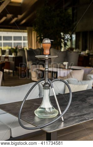 Hookah On The Table In The Restaurant. Vertical Photo