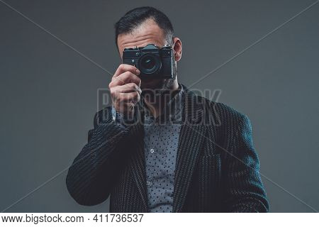 Modern Digital Camera. Front View Of A Middleaged Guy Wearing Custom Suit And Doing Shot With His Di