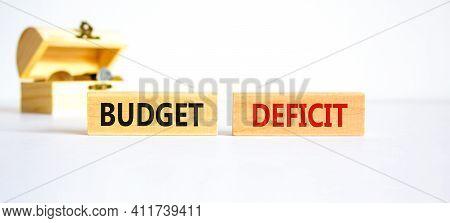 Budget Deficit Symbol. Concept Words 'budget Deficit' On Wooden Blocks On A Beautiful White Backgrou
