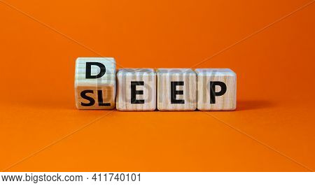 Sleep Deep Symbol. Turned A Wooden Cube With Words Sleep Deep. Beautiful Orange Background, Copy Spa
