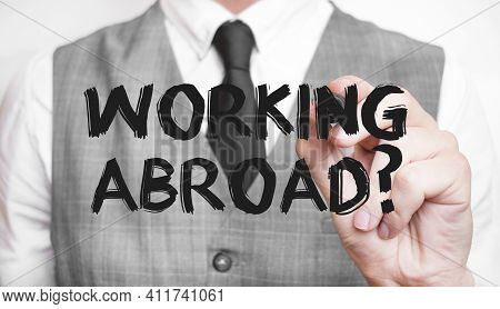 Businessman Writing Word Working Abroad With Marker, Business Concept
