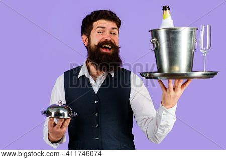 Restaurant Serving. Waiter With Serving Tray With Wine Cooler And Metal Cloche.
