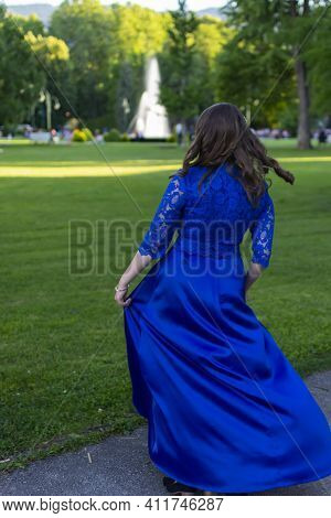 Prom Girl Spinning In A Modern And Elegant Blue Dress. Adorable And Fashionable Outfit. Beautiful Ph