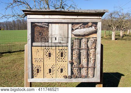 Insect Hotel. House For Insects. Close Up Of A Wooden And Brick Insect House Hotel.