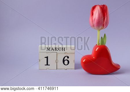 Calendar For March 16: Cubes With The Number 16, The Name Of The Month March In English, A Heart-sha