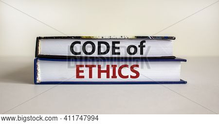 Code Of Ethics Symbol. Concept Words 'code Of Ethics' On Books On A Beautiful White Table, White Bac