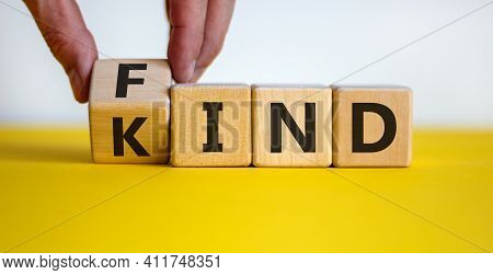 Find Your Kind Symbol. Businessman Turns Cubes With Words Find Kind. Beautiful Yellow Table, White B