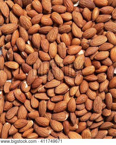 Roasted Peeled Almond Nuts Texture, Top View. Almond Nuts Background. Healthy Snack