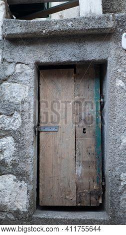 Variety Of Knockers And Handles On Ancient Doors In Italy. Old Metal Door Handle On A Wooden Door. A