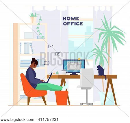 African American Woman Working Or Studying At Laptop From Home. Home Office Interior With Plants And