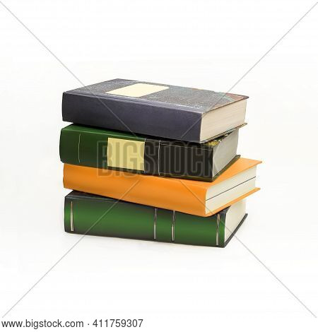Stack Of Books In Colour Covers With White Sheets Isolated On A White Background