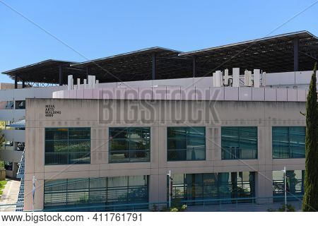 IRVINE, CALIFORNIA - 16 APRIL 2020: The Mesa Art Building and Parking Garage with Solar Panels on the campus of the University of California Irvine, UCI.