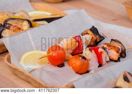 Cooked Scallop And Shrimp, Prawn Skewers In Paper Take Out Box At Summer Local Food Market - Close U