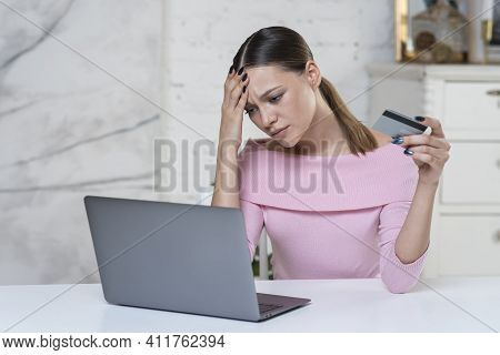 Sad Upset Frustrated Nervous Girl, Young Angry Unhappy Woman Is Holding Blocked Credit Bank Card In