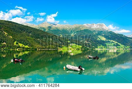 Inflatable Boats On Reschensee, An Artificial Lake In South Tyrol, The Italian Alps