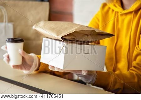 Woman In Gloves Work With Takeaway Orders. Waiter Giving Takeout Meal While City Covid 19 Lockdown,