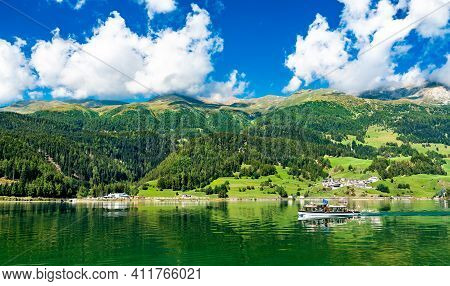 Passenger Boat On Reschensee, An Artificial Lake In South Tyrol, The Italian Alps