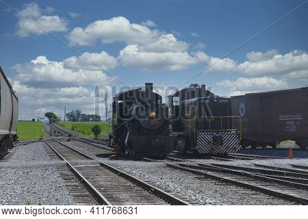 Strasburg, Pennsylvania, July 2018 - A 1906 Steam Locomotive And A Diesel Locomotive Seating Side By
