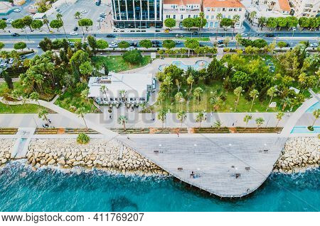 Molos Promenade Park With Alley And Wooden Pier For Walking People, Aerial View. Limassol City Coast