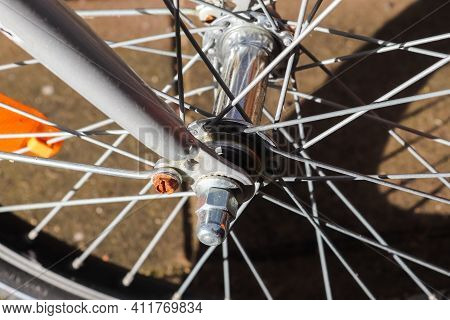 Selective Focus Close Up View At A Bicycle Wheel With Metal Spokes
