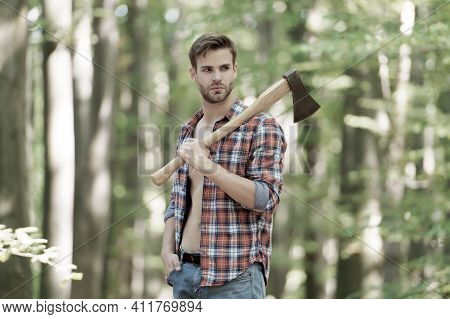 Sexy Male Woodcutter Hold Axe In Hands, Forest Life.