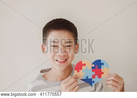 Teen Boy Holding Puzzle Jigsaw,  Preteen Child Mental Health Concept, World Autism Awareness Day, Au