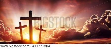 Crucifixion Of Jesus Christ- Three Crosses As Sunset