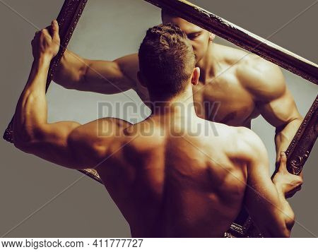 Sexy Man With Muscular Body With Bare Torso And Strong Back Holds Big Mirror
