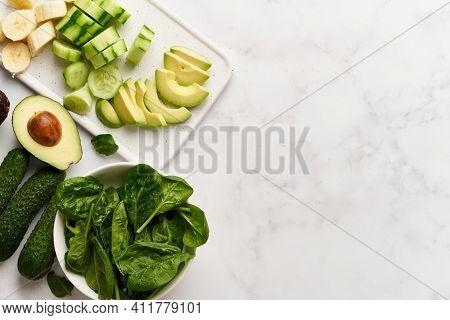 Vegan Food, Vegetarianism. Set Of Green Vegetables And Banana Slices, Ingredients For Smoothies. Pro