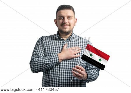 White Guy Holding A Flag Of Syria And Holds His Hand On His Heart Isolated On A White Background Wit