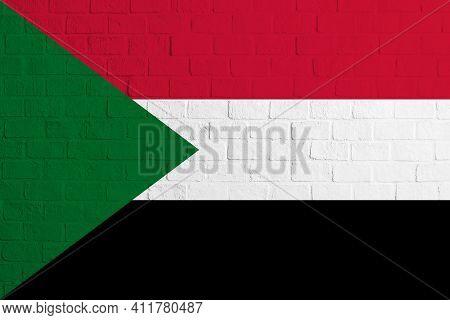 Flag Of Sudan. Brick Wall Texture Of The Flag Of Sudan.