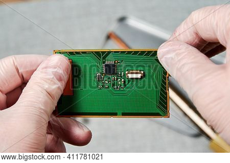 An Engineer Working On Repairing A Microchip In A Tech Laboratory. Manufacturing And Nanotechnology
