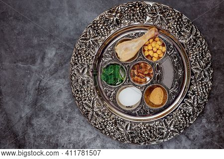Jewish Seder With Egg, Bone, Herbs And Walnut Passover Holiday Concept.