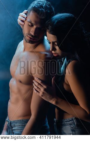 Sexy Woman Hugging Shirtless Man In Jeans On Black Background With Smoke.