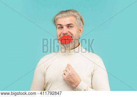 Photo Booth Concept. Man Holding Party Lips. Bearded Man With Photobooth Lips. Guy Sending Air Kiss