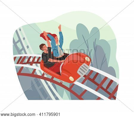 Young Couple Riding Roller Coaster Car In Amusement Park. Happy People On Top Of Rollercoasters. Fre