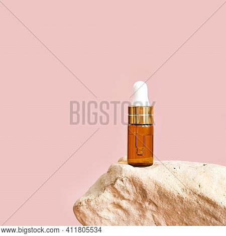 Cosmetology Product For Facial Care. Serum In Glass Bottle With Pipette On Stone. Essential Oil For