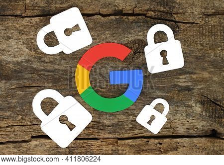 Kiev, Ukraine - February 19, 2021: Security Concept With Google Icon And Locks Printed On Paper And