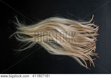 Photo Of Ready-made Keratin-encapsulated Strands Of Light Hair For Extension. High Quality Photo