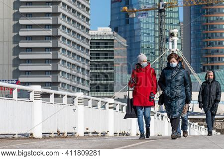 Vilnius, Lithuania - March 9 2021: Girls Or Women Walking With Mask During Covid Or Coronavirus Emer