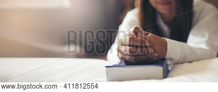 Prayer And Bible Concept. Hand Of Female Praying, Hope For Peace And Free, Hand In Hand Together By