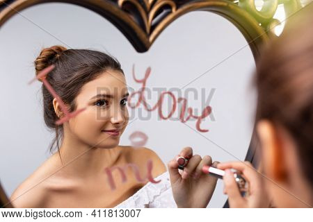 Portrait Of A Beautiful Caucasian Girl Looking In The Mirror And Writing I Love Me Near A Heart, Sel