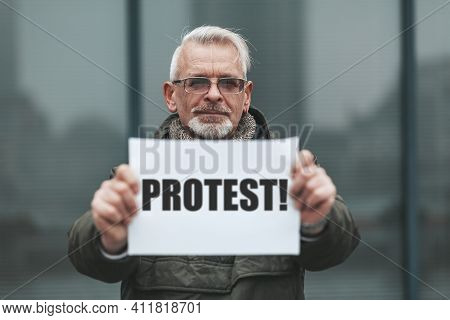 Senior Man Strike In The Street. A Mature Man's Protest. A Single Picket With A Banner For Your Righ
